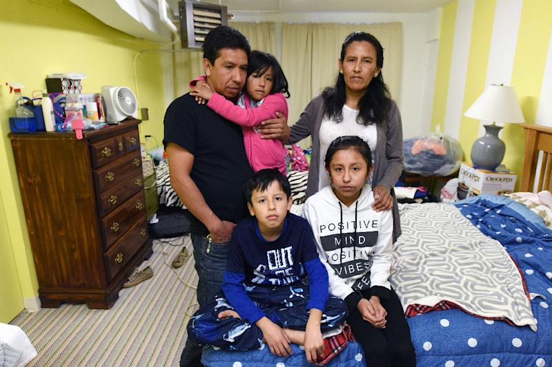 Nearly 20 years after fleeing Mexico Jeanette Vizguerra (top R) has taken refuge in a Denver church with her family for fear of being deported by immigration (AFP Photo/Chris Schneider)