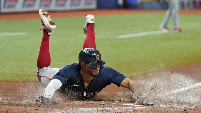 Boston Red Sox's Xander Bogaerts scores on an RBI single by Christian Vazquez off Tampa Bay Rays pitcher Josh Fleming during the fourth inning of a baseball game Friday, July 30, 2021, in St. Petersburg, Fla. (AP Photo/Chris O'Meara)