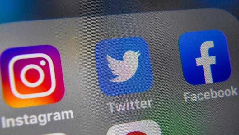 Facebook has said it will not intervene to check the veracity of political speech or ads, while Twitter has banned all political advertising (AFP Photo/Denis Charlet)