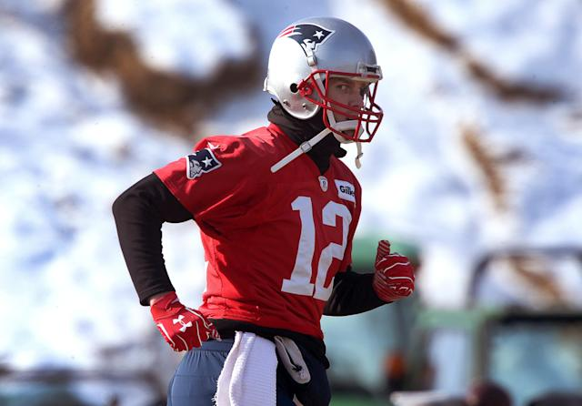 Tom Brady has been wearing gloves on both hands in practice. (Getty)
