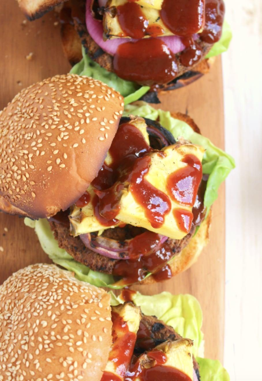 "<p>Loaded with grilled pineapples, red onions, and topped with a sweet BBQ sauce, these veggie burgers are the perfect summer dinner. The sweet pineapple pairs effortlessly with the veggie patties, making them a glorious treat.</p> <p><strong>Get the recipe</strong>: <a href=""https://delightfulemade.com/2015/06/30/hawaiian-veggie-burgers/"" class=""link rapid-noclick-resp"" rel=""nofollow noopener"" target=""_blank"" data-ylk=""slk:Hawaiian veggie burgers"">Hawaiian veggie burgers</a></p>"