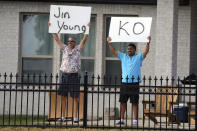 Spectators holds signs for Jin Young Ko as golfers play on the second green during the third round of the LPGA Volunteers of America Classic golf tournament in The Colony, Texas, Saturday, July 3, 2021. (AP Photo/Richard W. Rodriguez)