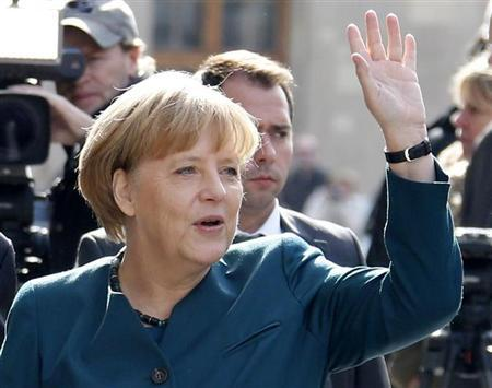 German Chancellor Merkel arrives for preliminary coalition talks with SPD in Berlin