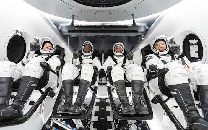 This SpaceX /NASA photo obtained the SpaceX Crew-1 crew members (L-R) NASA astronauts Shannon Walker, Victor Glover, Mike Hopkins, and JAXA (Japan Aerospace Exploration Agency) astronaut Soichi Noguchi  - AFP