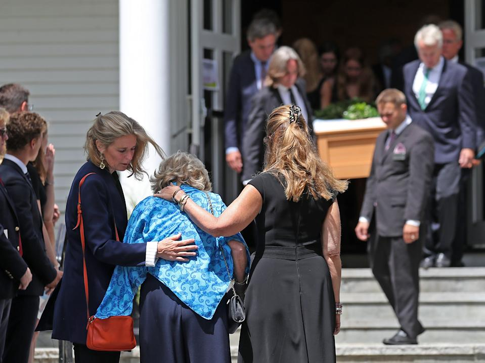 BARNSTABLE, MA - AUGUST 5: Courtney Kennedy Hill, center with head down, is consoled by Maria Shriver, right, and Sydney Lawford McKelvy, left, while she looks on as the casket of her daughter is taken from the church after funeral services for Saoirse Roisin Kennedy Hill are held at Our Lady of Victory Church in the Centerville section of Barnstable, MA on Aug. 5, 2019. Mourners gathered at Our Lady of Victory Church on Monday for the funeral of 22-year-old Saoirse Kennedy Hill, the granddaughter of Robert F. Kennedy who died last week. (Photo by David L. Ryan/The Boston Globe via Getty Images)