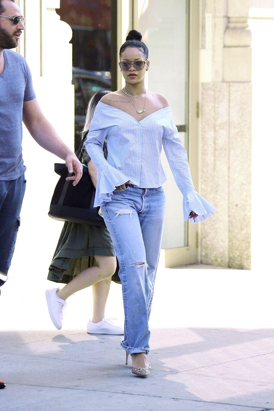 <p>Rihanna got super comfortable in slouchy boyfriend jeans, Rene Caovilla heels and an off-the-shoulder top on her way to VMA rehearsals in NYC.</p>