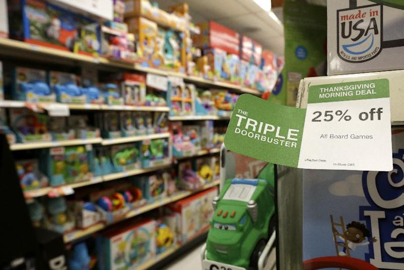 "In this Thursday, Nov. 28, 2013, photo, A ""Triple Doorbuster"" sale sign is placed at the toys section in Kmart during Grey Thursday shopping, Thursday, Nov. 28, 2013, in New York. Sales are up 2 percent through Sunday, Dec. 15, 2013, according to data obtained by The Associated Press from store data tracker ShopperTrak, on Wednesday, Dec. 18, 2013, which declined to give dollar figures. The modest growth so far comes as the amount of discounting stores are doing is up 13 percent from last year, the highest level its been since 2008 when stores were holding huge sales events to draw in recession-weary shoppers, according to research firm BMO Capital Markets. (AP Photo/Julio Cortez)"