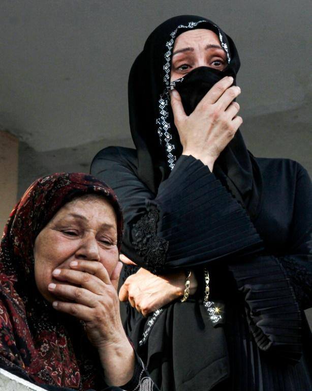 Family members of Imad Zahr al-Din, a worker at the port of Beirut who was killed in the massive explosion, mourn during his funeral at his home village of Burj Rahal, near Tyre in southern Lebanon