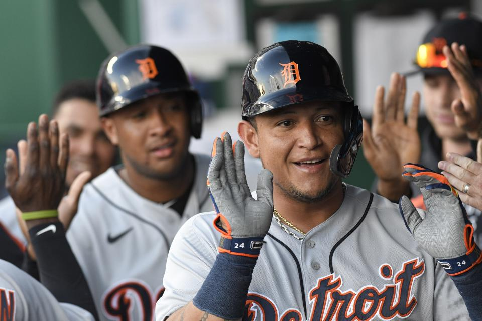 Detroit Tigers' Miguel Cabrera, front, celebrates with teammates, including Jonathan Schoop, behind, after they scored two runs during the first inning of a baseball game against the Kansas City Royals in Kansas City, Mo., Monday, June 14, 2021. (AP Photo/Reed Hoffmann)