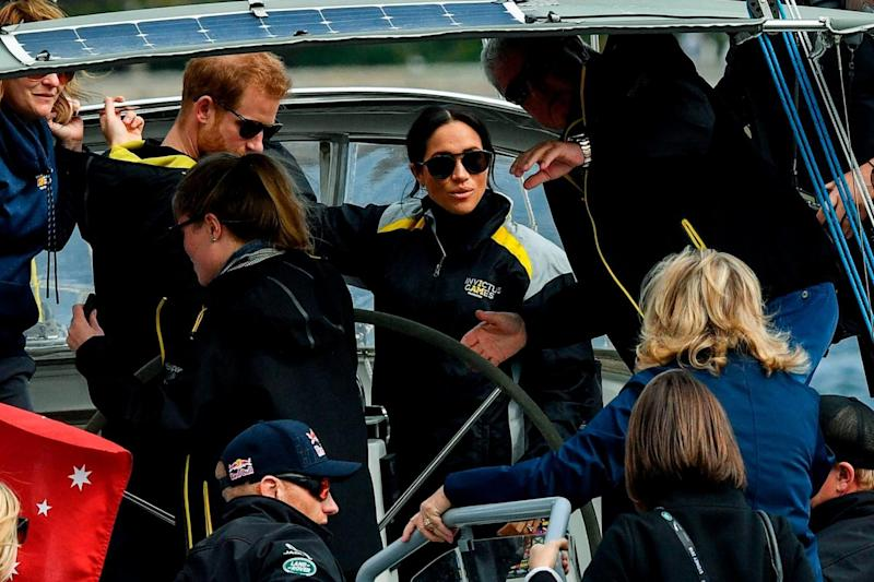 Harry and Meghan sail on Sydney Harbour on the first day of the Invictus Games (AFP/Getty Images)