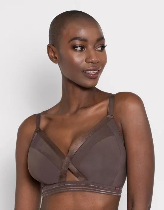 """<p><strong>Curvy Kate</strong></p><p>bravissimo.com</p><p><strong>$55.00</strong></p><p><a href=""""https://www.bravissimo.com/us/products/unwind-bralette-ck158/#cocoa-ck158coa"""" rel=""""nofollow noopener"""" target=""""_blank"""" data-ylk=""""slk:Shop Now"""" class=""""link rapid-noclick-resp"""">Shop Now</a></p><p>For sizes DD to JJ, Bravissimo's soft-touch bras are a sexy must-have. Most of their styles offer dual-sizing, too, meaning you can accommodate for one boob being a size or two larger than the other. What's sexier than comfort, anyway?</p>"""