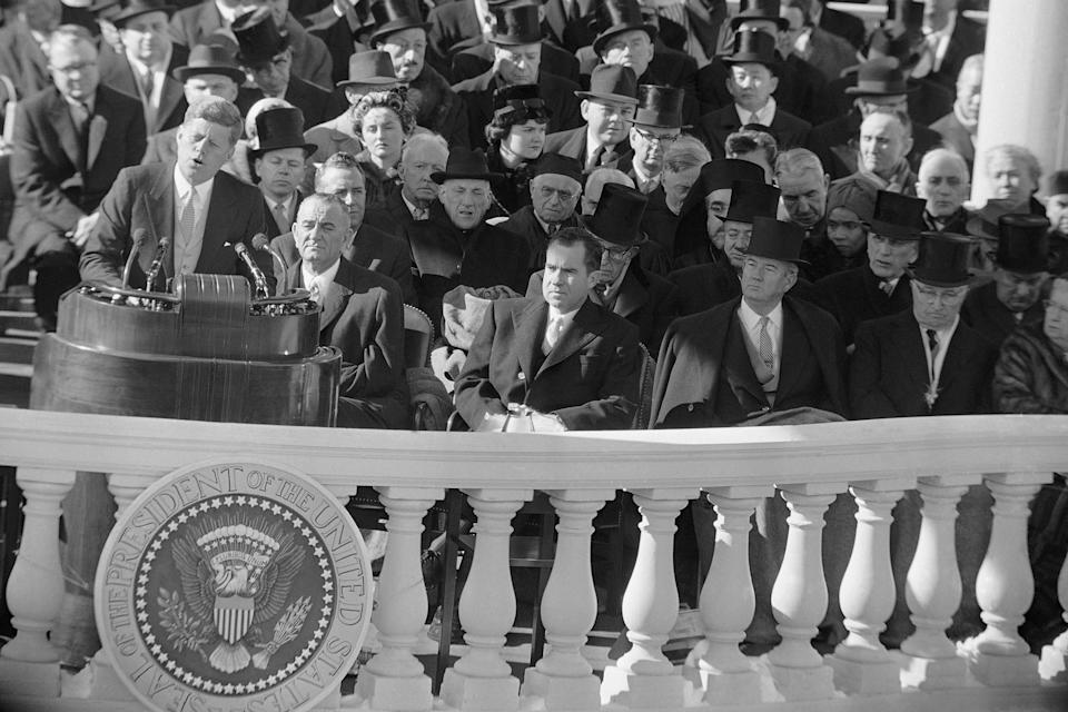 President John F Kennedy gives his inaugural address at the Capitol in Washington, on Jan. 20, 1961, after he took oath of office. Listening in front row of inaugural seats, from left, are, Vice President Lyndon B Johnson, Richard M Nixon, Kennedy's campaign opponent, Sen John Sparkman of Alabama, and former President Harry Truman. (AP Photo)