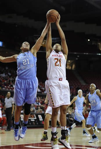 Maryland's Tianna Hawkins (21), foreground right, and North Carolina's Krista Gross reach for a rebound during the first half of an NCAA college basketball game on Thursday, Jan. 24, 2013, in College Park, Md. (AP Photo/Gail Burton)