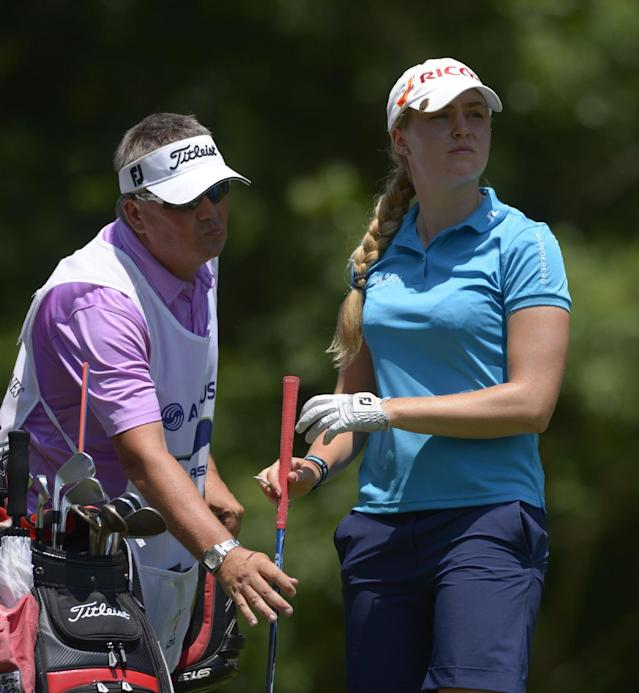 Charley Hull of England hands her club to her caddy after hitting her tee shot on the seventh hole during the second round of the Airbus LPGA Classic golf tournament at Magnolia Grove on Friday, May 23, 2014, in Mobile, Ala. (AP Photo/G.M. Andrews)