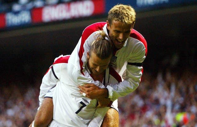 Beckham and Neville are former England and Manchester United team-mates (Andrew Parsons/PA).