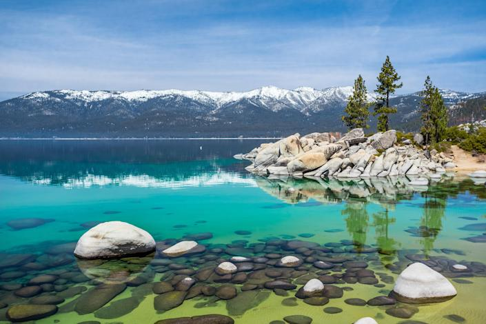"""<p>Ski season ends in Lake Tahoe after April, but the region still offers tons of great outdoor activities as the weather warms up. There really is something for everyone here, from hiking and biking to bird-watching and golf; or get on the water and explore the <a href=""""https://laketahoewatertrail.org/"""" rel=""""nofollow noopener"""" target=""""_blank"""" data-ylk=""""slk:Lake Tahoe Water Trail"""" class=""""link rapid-noclick-resp"""">Lake Tahoe Water Trail</a>, a 72-mile water route connecting public beaches with landing sites. For something extra special, take a """"Lit Up After Dark"""" tour with <a href=""""https://www.wildsocietylt.com/rates"""" rel=""""nofollow noopener"""" target=""""_blank"""" data-ylk=""""slk:Wild Society Adventures"""" class=""""link rapid-noclick-resp"""">Wild Society Adventures</a> to experience the lake after dark from a clear-bottom kayak.</p> <p><strong>Stay here:</strong> North Lake Tahoe's only waterfront resort, the <a href=""""https://cna.st/affiliate-link/2DU3NNvw6EUgkDaev9v9NzE19TzhWxScQHUMPB38MSm449kPYyMhotpvibUuNT2WMgAyzsCaZxdmZWA1mnEwW5pKYz6EZ35QwFUsNfesnk5Sp3aQjhd39Dg8JMKuQo3xuMWbwSt4f16zj2EzpfFYFa338k3spcmmhJJA5ZBcLDE5Zw?cid=606f16061243ed65f16c0da4"""" rel=""""nofollow noopener"""" target=""""_blank"""" data-ylk=""""slk:Hyatt Regency"""" class=""""link rapid-noclick-resp"""">Hyatt Regency</a>, encourages outdoor play year-round, and new on-site adventure and wellness specialists can plan electric bike tours on the Tahoe East Shore Trail (great for sunset watching), painting classes among the pines, or morning meditations at the resort's Water Garden.</p>"""