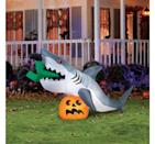 """<p>How epic is this <span>""""Caught by a Shark"""" Halloween Inflatable</span> ($86, originally $86)?</p>"""
