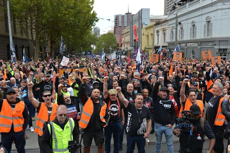 Unions and workers protest to demand better wages and increased job security in Melbourne, Australia on April 10, 2019. (Photo by Recep Sakar/Anadolu Agency/Getty Images)