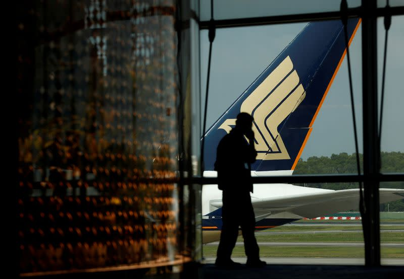 A Singapore Airlines plane sits on the tarmac at Singapore's Changi Airport