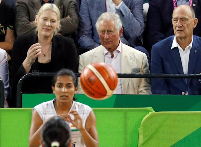 Britain's Prince Charles, sitting next to former Australian basketball player, Lauren Jackson, watches a women's Commonwealth Games basketball game between New Zealand and India, in Cairns, Australia April 8, 2018. REUTERS/Phil Noble/Pool