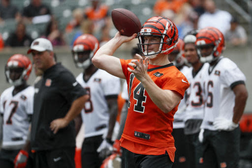 Cincinnati Bengals quarterback Andy Dalton throws a pass during practice at the NFL football team's training camp, Tuesday, June 12, 2018, in Cincinnati. (AP Photo/John Minchillo)
