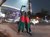 Bangladesh Cricket Lovers and dress code Bangladesh National Flag and taken Mobile Selfie at front of The Eden Garden Cricket Stadium and Pink illuminated on November 21,2019 in Kolkata,India. a historic venue, getting ready to host Indias first Day-Night Pink Ball Test from November 22. Indias opponent is Bangladesh and the haze seems to denote the mists of time through which Kolkatas prized playing field has come with credit, being witness to many a humdinger across formats. (Photo by Debajyoti Chakraborty/NurPhoto via Getty Images)