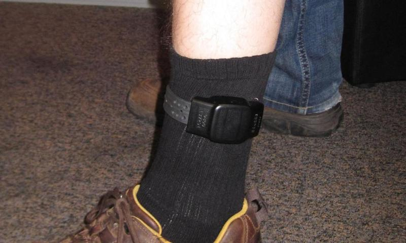 A person wearing an electronic ankle tag