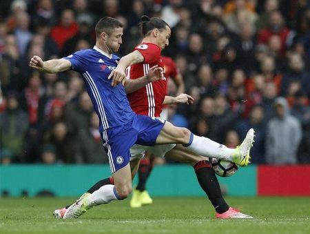 Britain Soccer Football - Manchester United v Chelsea - Premier League - Old Trafford - 16/4/17 Chelsea's Gary Cahill in action with Manchester United's Zlatan Ibrahimovic  Reuters / Phil Noble Livepic