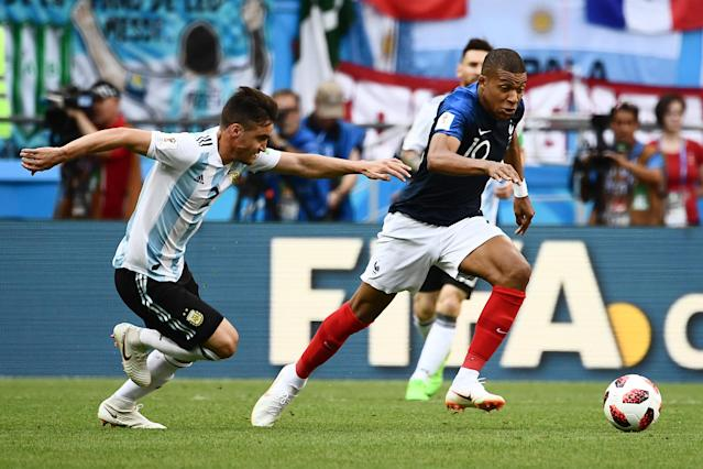 France's forward Kylian Mbappe (R) is marked by Argentina's defender Nicolas Tagliafico during the Russia 2018 World Cup round of 16 football match between France and Argentina at the Kazan Arena in Kazan on June 30, 2018. (Getty Images)