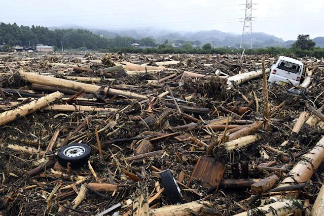 <p>Debris caused by heavy rain are left in Asakura, Fukuoka prefecture, southwestern Japan Thursday, July 6, 2017. Heavy rain following a recent typhoon flooded many houses in southwestern Japan, forcing thousands of people to flee, authorities said. (Photo: Sadayuki Goto/Kyodo News via AP) </p>