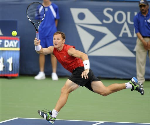 Michael Russell, of the United States, dashes across the court for a return to Tommy Haas, of Germany, during a match in the Citi Open tennis tournament, Tuesday, July 31, 2012, in Washington. (AP Photo/Nick Wass)