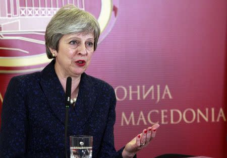 British Prime Minister Theresa May addresses a news conference in Skopje