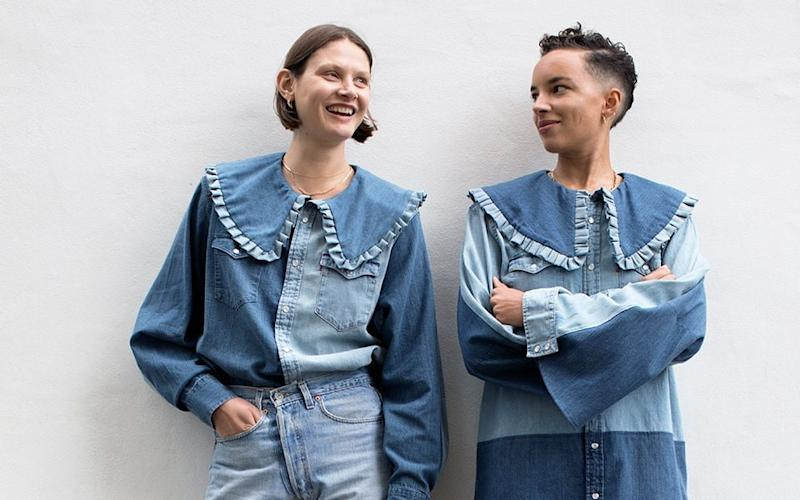 Victoria Sekrier and Phoebe Collings-James wearing the new Ganni x Levi's Love Letter collection in London - Clare Shilland