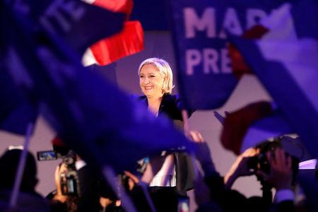 Marine Le Pen, French National Front political party leader, celebrates after early results in the first round of 2017 French presidential election, in Henin-Beaumont, France. REUTERS/Charles Platiau