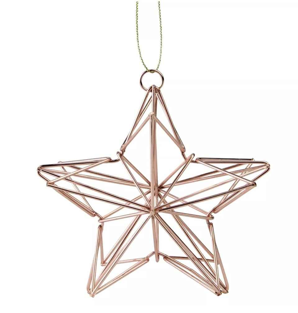 """<p>You'll hang this <span>Northlight 4.5"""" Rose Gold Geometric Wire Star Christmas Ornament</span> ($8, originally $10) on your tree for years to come. </p>"""