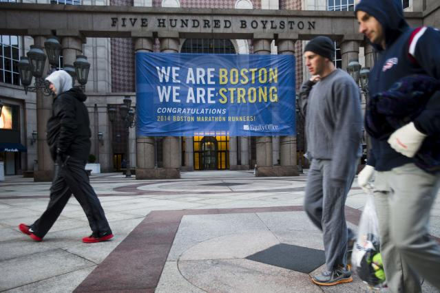 Runners make their way to load onto busses ahead of the 118th Boston Marathon Monday, April 21, 2014 in Boston. (AP Photo/Matt Rourke)
