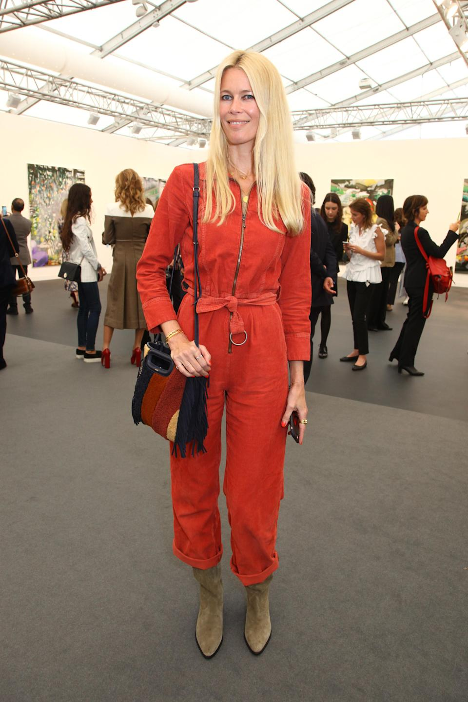 <p>On 3 October, Claudia Schiffer attended a VIP Preview of the Frieze Art Fair in Regents Park in London, England. She wore a utility style orange jumpsuit by MIH Jeans paired with stone coloured Isabel Marant boots and a Maje bag. <i>[Photo: Getty]</i> </p>