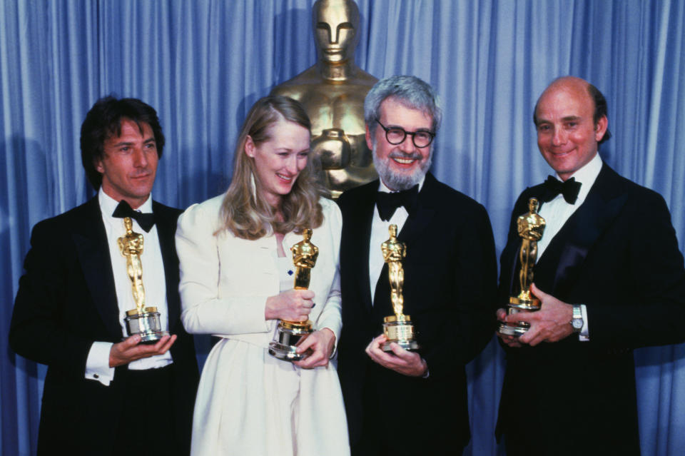The big winners of the movie, Kramer vs. Kramer, hold up four of the Oscars won by the film at the 52nd Annual Award presentations. (AP)