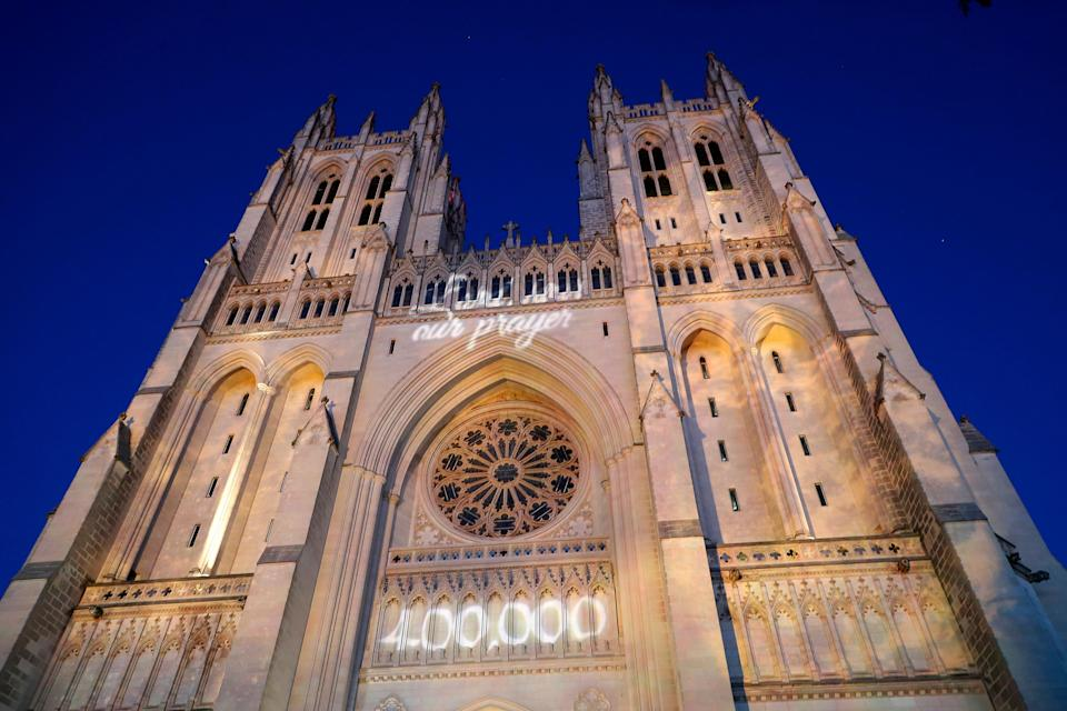 The grim COVID-19 milestone was projected onto the National Cathedral to honor the pandemic's victims. (Photo: Paul Morigi via Getty Images)