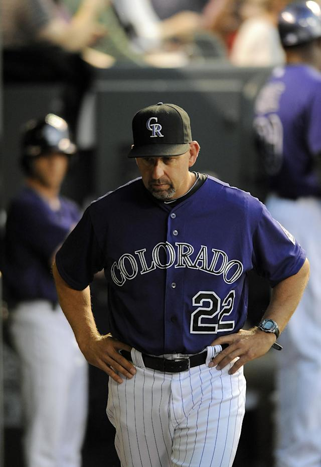 Colorado Rockies manager Walt Weiss stands in the dugout in the fourth inning of a baseball game against the Atlanta Braves on Monday, June 9, 2014, in Denver. (AP Photo/Chris Schneider)