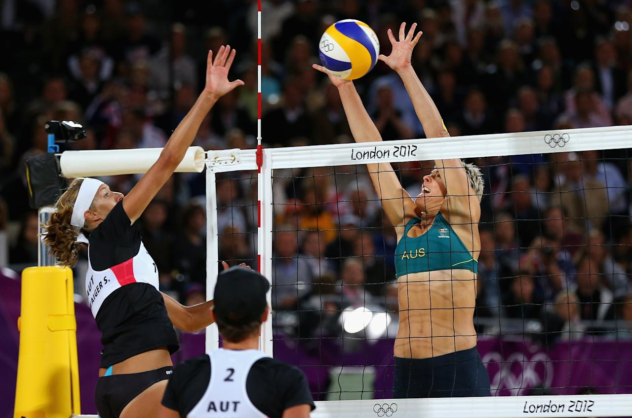LONDON, ENGLAND - JULY 30:  Nat Cook of Australia blocks against Stefanie Schwaiger of Austria during the Women's Beach Volleyball Preliminary match between Australia and Austria on Day 3 of the London 2012 Olympic Games at Horse Guards Parade on July 30, 2012 in London, England.  (Photo by Ryan Pierse/Getty Images)