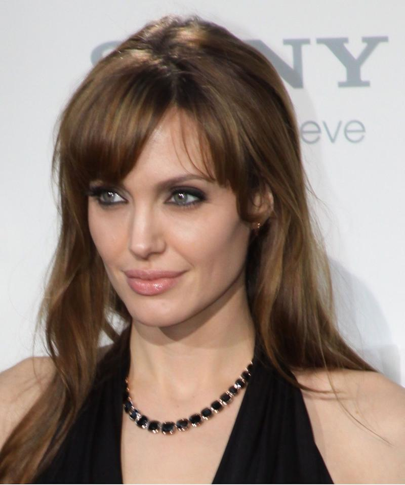 Angelina Jolie stuns in a black dress at a Sony event, and she looks incredibly gorgeous