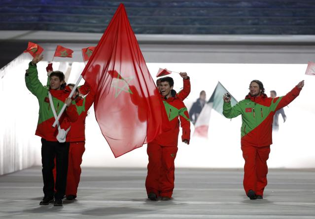 Morocco's flag-bearer Adam Lamhamedi leads his country's contingent during the athletes' parade at the opening ceremony of the 2014 Sochi Winter Olympics, February 7, 2014. REUTERS/Phil Noble (RUSSIA - Tags: OLYMPICS SPORT)