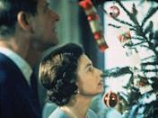 <p>Prince Philip and Queen Elizabeth inspect their Christmas tree during the filming of a TV special.</p>