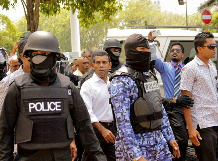 Former Maldives president Mohamed Nasheed (C, in white) is arrested in Male on March 5, 2013