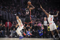 Miami Heat forward Jimmy Butler shoots as Los Angeles Clippers forward Kawhi Leonard, right, defends along with guard Landry Shamet during the first half of an NBA basketball game Wednesday, Feb. 5, 2020, in Los Angeles. (AP Photo/Mark J. Terrill)