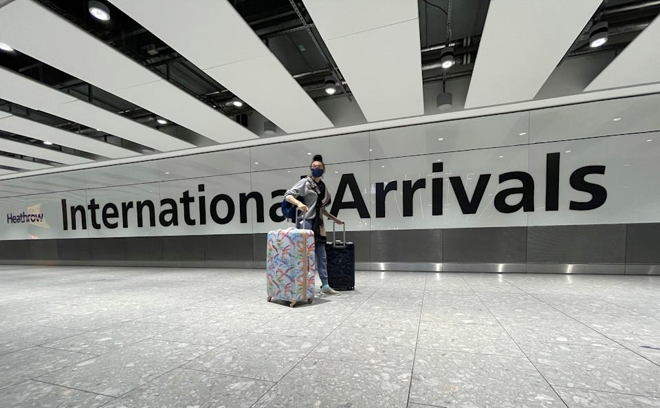 <strong>Travellers arrive at Heathrow Airport in London, Sunday, January 17.</strong> (Photo: ASSOCIATED PRESS)