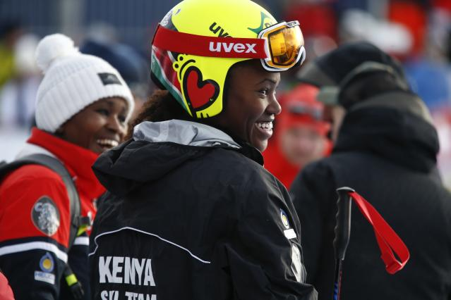 Kenya's Sabrina Simader smiles in the finish area after completing an alpine ski, women's World Cup super-G, in St. Moritz, Switzerland, Saturday, Dec. 9, 2017. (AP Photo/Giovanni Auletta)