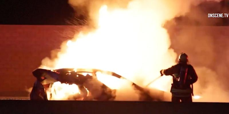 A vehicle carrying a family of three on a Los Angeles freeway caught on fire after a collision with an off-duty officer's vehicle, authorities said.
