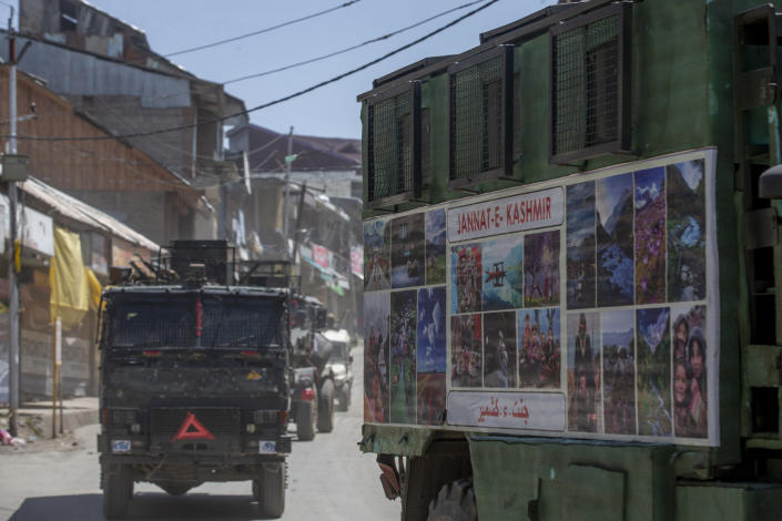 Indian army vehicles leave after the site of a gunbattle between Indian soldiers and suspected militants in Shopian, south of Srinagar, Indian controlled Kashmir, Friday, April 9, 2021. Seven suspected militants were killed and four soldiers wounded in two separate gunfights in Indian-controlled Kashmir, officials said Friday, triggering anti-India protests and clashes in the disputed region. (AP Photo/ Dar Yasin)